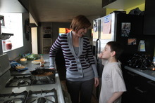 Rick Egan   |  The Salt Lake Tribune  Angie Watson chats with her 9-year-old son Noah,  as she prepares dinner, Monday, April 25, 2011. On Dec. 5, 2010 Watson found her 13-year-old son (Connor) dead from a prescription drug overdose. He had taken oxycodone from a friend's house, whose grandmother had left it and other medications sitting out on a kitchen counter.