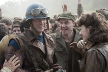 Chris Evans (left) plays Steve Rogers and Hayley Atwell (right) plays Peggy Carter in