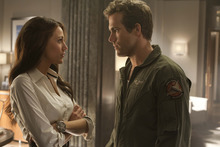 Hal Jordan (Ryan Reynolds, right) tries to explain his new powers to Carol Ferris (Blake Lively) in