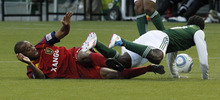 Real Salt Lake midfielder Collen Warner, left, trips up Portland Timbers defender Chris Taylor during the first half of their MLS soccer game in Portland, Ore., Saturday, April, 30, 2011. (AP Photo/Don Ryan)