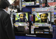 A Japanese watches TV on the death of Osama bin Laden, at an electronics retailer in Tokyo on Monday May 2, 2011. Obama said Osama bin Laden, the glowering mastermind behind the Sept. 11, 2001, terror attacks that killed thousands of Americans, was killed in an operation led by the United States. (AP Photo/Koji Sasahara)