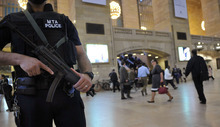 An armed Metropolitan Transportation Authority police officer stands guard in New York's Grand Central Station on  Monday, May 2, 2011. Security was heightened as a result of the announcement of the killing of Osama Bin Laden. (AP Photo/Stephen Chernin)