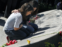 Sisters Carie, left, and Danielle Lemack whose mother Judy Larocque died on ill-fated Flight 11 from Logan Airport on 9/11, grieve in Boston Monday, May 2, 2011 at the Garden of Remembrance, a memorial dedicated to the 206 Massachusetts victims of September 11, 2001. The event was held in the wake of news of the death of Osama bin Laden. (AP Photo/Elise Amendola)