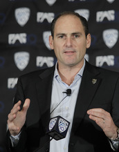 FILE - This Oct. 21, 2010, file photo shows Pac-10 commissioner Larry Scott announcing the splitting of NCAA college football divisions during a news conference in San Francisco. The Pac-10 agreed to a 12-year television contract with Fox and ESPN on Tuesday, May 3, 2011,  that will more than triple its media rights fees and be the most valuable for any conference in college sports.(AP Photo/Paul Sakuma, File)