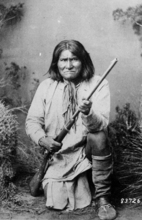 FILE  |  The Associated Press A National Archives photo shows the famed Indian warrior Geronimo, a Chiricahua Apache, posing in 1887 with a rifle. The leader of the Fort Sill Apache Tribe is looking for a formal apology from President Barack Obama for the government's use of the code name