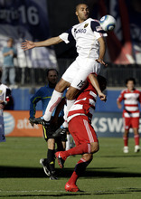 Real Salt Lake forward Alvaro Saborio (15) goes up for the ball against FC Dallas defender/midfielder Daniel Hernandez (2) during the first half of the MLS Western Conference semifinals soccer game in  Frico, Texas, Saturday, Oct. 30, 2010 (AP Photo/LM Otero)