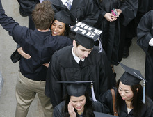 Scott Sommerdorf     The Salt Lake Tribune One student had a message for potential employers as he walked in the procession to The Spectrum for Utah State's Graduation ceremonies in Logan, Saturday, May 7, 2011.