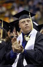 Scott Sommerdorf     The Salt Lake Tribune Robbie Petersen, a survivor of the 2005 van accident that killed eight students and an instructor, applauds as teachers in the audience are recognized during Utah State's Graduation in Logan, Saturday, May 7, 2011.