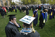 Scott Sommerdorf     The Salt Lake Tribune Brent Ewell adorned his mortarboard with a message for loved ones as he waiting in the quad for the procession to The Spectrum for Utah State's Graduation in Logan, Saturday, May 7, 2011. Ewell earned his degree in Science.