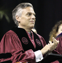 Former U.S. Ambassador to China and former Utah Gov. Jon Huntsman applauds at the commencement ceremony at the University of South Carolina on Saturday, May 7 2011 in Columbia, S.C.  Huntsman, weighing a Republican White House bid, used his first formal event after stepping down as President Barack Obama's ambassador to China to confront the line on his resume that conservatives were mostly likely to declare a deal-breaker. In a high-profile speech to the University of South Carolina, Huntsman said patriotism should trump partisanship and defended his two years in Beijing as the Democratic administration's top diplomat. (AP Photo/Mary Ann Chastain)