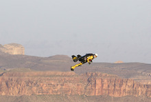 Breitling     The Associated Press Swiss adventurer Yves Rossy flys over the Grand Canyon in Arizona on Saturday in his custom-built jet suit.