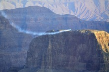 In this photo provided by Breitling, Swiss adventurer Yves Rossy is seen during his flight over the Grand Canyon in Arizona on Saturday, May 7, 2011.  The 51-year-old Rossy was airborne for more than eight minutes, soaring 200 feet above the canyon rim on the Hualapai Reservation.  Rossy's sponsor, Swiss watchmaker Breitling, announced the successful flight Tuesday, May 10, 2011.   (AP Photos/Breitling, Alain Ernoult)