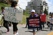 Pilar Lopez, left, marches with her daughter Narian Lopez, 5, in this file photo from a May 1, 2011, march at the Utah State Capitol. (Normand Garcia, Ahora Utah)