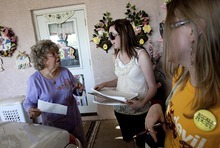 Djamila Grossman     The Salt Lake Tribune  Arizona State University students Gloria Cameron and Amanda Casas talk to Nancy Kimball of Mesa after she signed a petition to recall Arizona Senate President Russell Pearce, R-Mesa, in Mesa, Arizona, on Sunday, April 17, 2011.