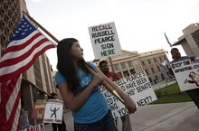 DJAMILA GROSSMAN     The Salt Lake Tribune Twelve-year-old Alma Olague participates in a demonstration in front of the state Capitol protesting Arizona's tough immigration enforcement law and calling for the ouster of Senate President Russell Pearce. Pearce is the main sponsor and advocate of the law.