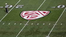 Michael Mangum  |  The Salt Lake Tribune  The new PAC-12 logo is shown on the field during a spring practice session at Rice-Eccles Stadium on Monday, April 11, 2011.