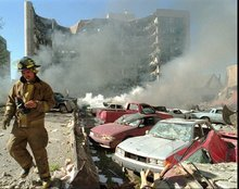 In this April 19, 1995 file photo, an Oklahoma City fireman walks near explosion-damaged cars on the north side of the Alfred Murrah Federal Building in Oklahoma City after a car bomb blast. More than 600 people were injured in the attack and 168 people were killed. Timothy McVeigh was executed in 2001 and Terry Nichols is serving multiple life sentences on federal and state convictions for their convictions in the bombing. (AP Photo/The Daily Oklahoman, Jim Argo, File)
