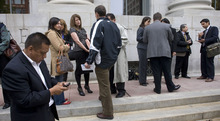 STEVE GRIFFIN  |  The Salt Lake Tribune ACLU attorneys, media and others gather outside the Frank Moss Federal Courthouse in Salt Lake City on Tuesday after U.S. District Judge Clark Waddoups blocked Utah's immigration enforcement law from taking effect.