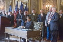 PAUL FRAUGHTON  |  The Salt Lake Tribune  Utah Gov. Gary Herbert on Tuesday signed into law immigration  bills passed in this year's legislative session, including a controversial guest worker plan. The signing ceremony included leading lawmakers, LDS Presiding Bishop H. David Burton, far left, Sutherland Institute President Paul Mero, fourth from left, and Salt Lake Chamber of Commer President Lane Beattie, sixth from left.