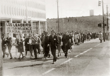 Students and faculty from the University of Utah, along with members of the NAACP, marched in downtown Salt Lake City in 1965 calling for the leadership of the LDS Church to use their influence for moral justice in the Civil Rights movement. Credit: The Daily Utah Chronicle/KUED