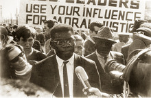 John Driver, the head of the Utah chapter of the NAACP, answers questions at the 1965 march in Salt Lake City. Credit: The Daily Utah Chronicle/KUED