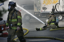 SCOTT SOMMERDORF  |  The Salt Lake Tribune Fire crews from Murray, Sandy and Salt Lake worked a four alarm fire Saturday at an unoccupied building near 600 West between 200 and 300 South across from the Intermodal Hub. No injuries were reported and the cause was being investigated.