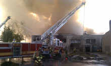 Salt Lake City ladder trucks shoot water into an old furniture building on 600 West near 200 South on Saturday, May 15, 2011. There were no occupants in the building and no inures reported. Photo by Nate Carlisle/The Salt Lake Tribune