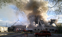 Firefighters combat a blaze at the old Intermountain Furniture MFG. Co. building in Salt Lake City, as seen here from 300 South near 500 West. Photo by Nate Carlisle/Salt Lake Tribune