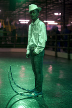 In this picture taken Saturday, May 7, 2011, Guadalupe Silva, 20, poses for a portrait during a break at the Mesquit Rodeo nightclub in Matehuala, Mexico. The flashy pointy boot-craze has swept through the Mexican town of Matehuala, spread to nearby cities and is being taken by migrants across the border into the United States. (AP Photo/Dario Lopez-Mills)