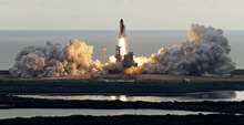 The space shuttle Endeavour clears the launch pad at Cape Canaveral, Fla., on Monday. Chris O'Meara     The Associated Press
