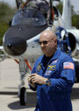 FILE - In this April 26, 2011 file photo, Mark Kelly, commander of the space shuttle Endeavour, walks past a T-38 jet after arriving at Kennedy Space Center with his fellow crew members in Cape Canaveral, Fla.  Kelly's wife, Arizona congresswoman Gabrielle Giffords, left Houston for Cape Canaveral late Wednesday morning, April 27, 2011 to watch the liftoff of the space shuttle Endeavour, scheduled for Friday afternoon. (AP Photo/Chris O'Meara, File)