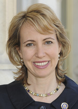 FILE - In this March 2010 file photo provided by the office of Rep. Gabrielle Giffords, D-Ariz., Giffords poses for a photo. Still recovering from a gunshot wound to the head, Giffords was at Kennedy Space Center on Monday, May 16, 2011, to witness husband Mark Kelly and his five crewmates blast off and head to the International Space Station.  (AP Photo/Office of Rep. Gabrielle Giffords, File)
