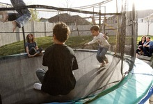 Trent Nelson  |  The Salt Lake Tribune New state Sen. Aaron Osmond and his wife, Nancy, watch Daniel, Madalyn, Ryan and Jackson jump on a trampoline on Friday in their backyard in South Jordan.