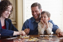 Trent Nelson  |  The Salt Lake Tribune New state Sen. Aaron Osmond plays a game of Risk on Friday with wife Nancy and son Jackson.