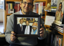 Sarah A. Miller     The Salt Lake Tribune  Artifact collector Christopher Kortlander holds a photo of himself with President Barack Obama, left, and Dr. Joe Medicine Crow, right, after Crow received the Presidential Medal of Freedom. Kortlander is suing the federal government, saying it violated his rights during a raid of artifacts that occurred on his property in 2005.