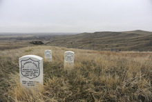 Sarah A. Miller     The Salt Lake Tribune  Headstones mark where three U.S. soldiers fell during the Battle of Little Bighorn. Taking artifacts from American Indian lands and the national monument is illegal.