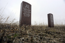 Sarah A. Miller     The Salt Lake Tribune  Headstones mark where two Cheyenne warriors fell during the Battle of Little Bighorn. Taking artifacts from American Indian lands and the national monument is illegal.