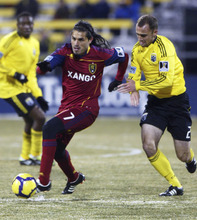 Special to the Tribune  Real Salt Lake's Fabian Espindola, left, escapes the Columbus Crew's Rich Balchan, right, during a CONCACAF Champions League game.