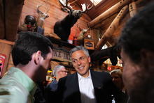 Cheryl Senter  |  The Associated Press Former Utah Gov. Jon Huntsman Jr., center, talks to people at a meet and greet Thursday in Lebanon, N.H. Huntsman, who is exploring a presidential bid, has not decided to make his run official, but has made trips to Florida and South Carolina recently in addition to New Hampshire.