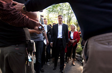 Cheryl Senter  |  The Associated Press Former Utah Gov. Jon Huntsman Jr., center, with wife Mary Kaye, right, heads to a meet and greet Thursday in Lebanon, N.H. Huntsman, who is exploring a presidential bid, has not decided to make his run official, but has made trips to Florida and South Carolina recently in addition to New Hampshire.