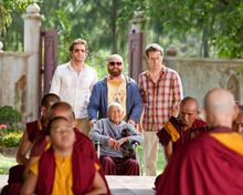 In this publicity image released by Warner Bros., from left, Bradley Cooper, Zach Galifianakis and Ed Helms are shown in a scene from