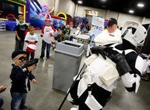 Trent Nelson  |  The Salt Lake Tribune Dressed as a scout trooper, Ryan Simmons reacts to being