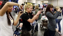 Trent Nelson  |  The Salt Lake Tribune Mothers take photos of their children posing with Ryan Simmons, dressed as a Star Wars scout trooper, at the Utah Baby and Kidz Expo at the South Towne Expo Center in Sandy. Simmons and other members of the Alpine Garrison volunteer their time dressing up in Star Wars costumes to entertain children and raise money for charities.