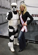Trent Nelson  |  The Salt Lake Tribune Dressed as an Imperial scout trooper, Ryan Simmons poses with Mrs. Utah America Carol Guest at the Utah Baby and Kidz Expo. Simmons and other members of the Alpine Garrison volunteer their time dressing up in Star Wars costumes to entertain children and raise money for charities.