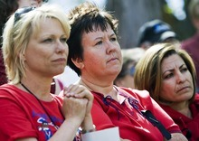 Djamila Grossman  |  The Salt Lake Tribune From left, Judy Shiery, Terri Jorgensen and Laura Coria of James Madison Elementary School and other Ogden teachers listen during a protest in front of the Ogden School District offices on Thursday. Ogden teachers have worked the whole school year without a contract.