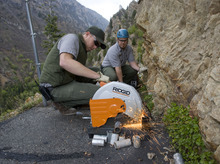 Al Hartmann  |  The Salt Lake Tribune Timpanogos Cave National National Monument maintenance workers Jacob Hinton, left, and Kody Hill cut steel pipe to construct a cable fence along an exposed part of the trail to the cave in American Fork Canyon.   The monument has made many safety improvements along the steep 1.5-mile trail leading to the cave in several dangerous areas in the wake of recent falls over the past few years, including the death of an employee last year.  The trail improvements are to be mostly finished this week as the cave opens for the 2011 season May 27.
