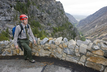 Al Hartmann  |  The Salt Lake Tribune Denis Davis, superintendent of Timpanogos Cave National National Monument in American Fork Canyon, walks along a new stretch of rock wall built along an exposed part of the trail.   The monument has made many safety improvements along the steep 1.5-mile trail leading to the cave in several dangerous areas in the wake of recent falls over the past few years, including the death of an employee last year.  The trail improvements are to be mostly finished this week as the cave opens for the 2011 season May 27.