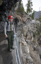 Al Hartmann  |  The Salt Lake Tribune Denis Davis, superintendent of Timpanogos Cave National National Monument in American Fork Canyon, checks out a new stretch of post and cable fencing along an exposed part of the trail. This is the area where Rex Walker, an employee, left the trail while riding a motorized vehicle and perished. The monument has made many safety improvements along the steep 1.5-mile trail leading to the cave in several dangerous areas in the wake of recent falls over the past few years, including the death of an employee last year.  The trail improvements are to be mostly finished this week as the cave opens for the 2011 season May 27.
