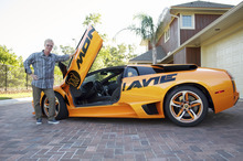 Courtesy image  Brig Hart, the top distributor at MonaVie, poses with his Lamborghini. Hart is likely the top-earning multilevel marketer in the world, at one time earning more than $600,000 a month.