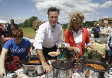 Former Massachusetts Gov. Mitt Romney, and his wife Ann, serve chili at Bittersweet Farm in Stratham, NH., Thursday, June 2, 2011, before he announced he is running for President of the United States during a campaign event. (AP Photo/Stephan Savoia)